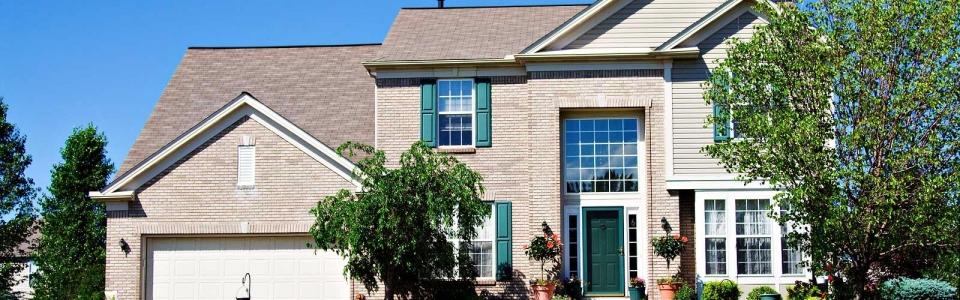 bigstock-Brick-Suburban-House-21074225